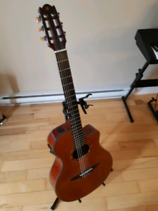 $500.  Yamaha cross over classical guitar with electronics and b