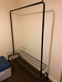 Black metal clothes rail and basket