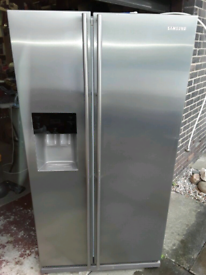 Silver Samsung amercain Water and ice dispenser fridge freezer