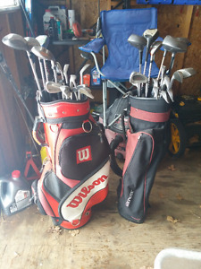 2 Sets of clubs plus bags
