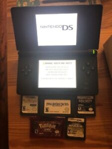 Nintendo DS Lite with games and extra styluses