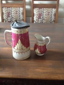 Victorian jug with pewter lid and small jug