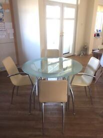 BEAUTIFUL GLASS CIRCULAR TABLE & 4 CHAIRS FOR SALE!