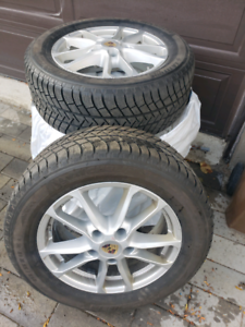 255/55/r18 .4 winter tiers  Michelin  With mags wells