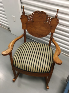 Antique rocking chair with green and white stripe seat