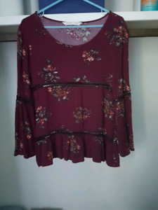 Bell sleeve burgandy shirt with detailing on it