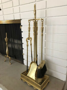 Classic 4 piece polished brass fireplace tool set with stand.
