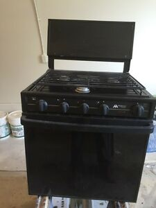 Selling a user black stove and Oven. 21 inch