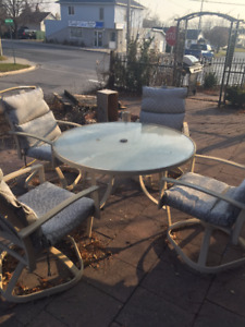 Glass top patio set with chairs and cushions