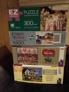 4 assorted jigsaw puzzles