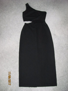 Long black dress, over one shoulder and cut out at waist