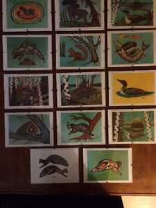 A complete set of local artist Noel Decharme Card prints