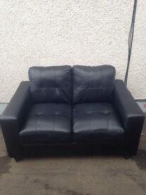 2 seater black faux leather sofa. Designer sofa