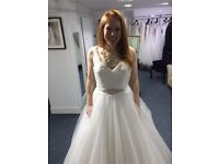 Brand new, stunning allure wedding dress, size 10. With underskirt.