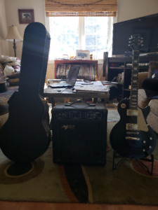 Epiphone Les Paul with hardshell case, amp, and stand