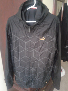 Like new black and gold men's large Puma light hooded jacket.