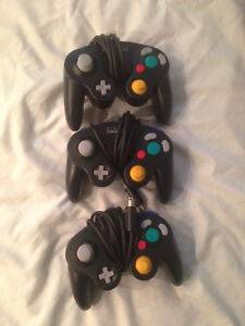 nintendo gamecube with tons of games and controllers
