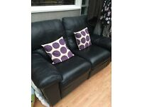 Two seater leather reclining couch