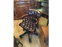 Oxlblood leather captains chair