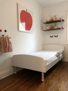 Kids single bed with mattress and safety rail.