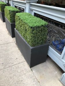 planters and faux shrubs