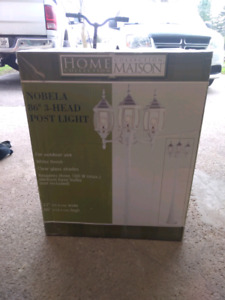 New 3 head post light for sale.