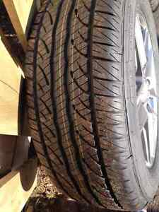 BRAND NEW ALL SEASON RIM AND TIRES