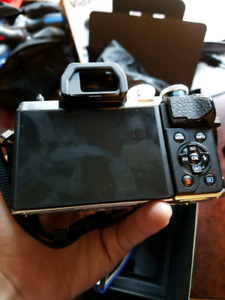 Olympus E-M10 Mk III with 14-42mm lens
