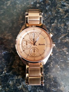 Roots rose gold watch