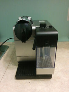 nespresso coffee maker with attached frother