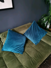 Two teal cushions