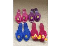 4 pairs of Disney dress up shoes.