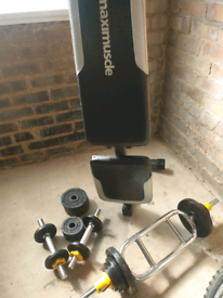 GYM BENCH AND CAST IRONWEIGHTS