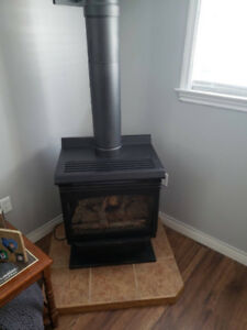 Propane fireplace (with brand new exhaust) and hearth $500 obo