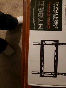 Brand New Never Opened TV wall mount upto 55 inches NEW !!