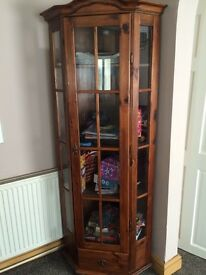 Wooden corner unit with shelves and lights ,