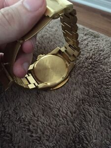 Selling Nixon gold watch mint condition  London Ontario image 3