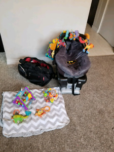 Carseat with covers, diaper bag and toys