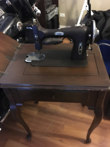 antique electric sewing machine in cabinet