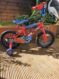 Boy spider man bike