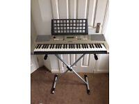 Yamaha PSR E313 portable piano.