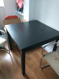 Black extendable IKEA dining table