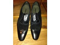 Men's black leather shoes with suede insert