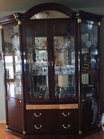 dining room table with 8 chairs and a cabinet