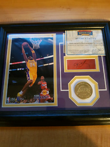 Autographed Dennis Rodman and kobe Bryant framed pictures