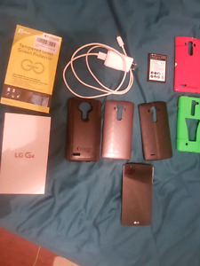 LG G4 like new condition no scratches lots to go with it
