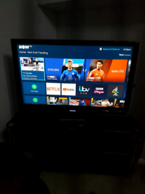 """40"""" Toshiba TV with remote, stand and wall bracket."""