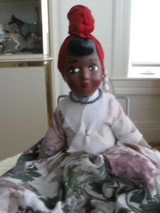 BLACK PADDED COLLECTOR'S DOLL LOOKING HER BEST