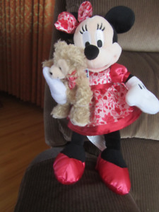 Minnie Mouse Holding Duffy Bear