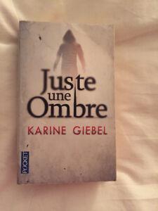 ''Juste une ombre''  de Karine Giebel, Pocket. Roman policier.